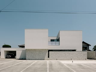 *studio LOOP 建築設計事務所 Modern houses White