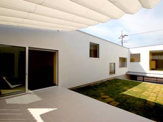 中庭: 小島光晴建築設計事務所が手掛けた庭です。