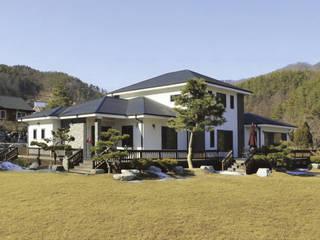 양평군 봉상리 중목구조주택 (90PY): 한다움건설의  목조 주택