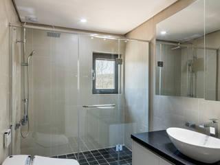 Phòng tắm phong cách hiện đại bởi 투엠투건축사사무소 Hiện đại