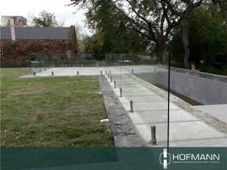 BARANDAS DE VIDRIO PARA PILETAS de HOFMANN - DESARROLLOS EN VIDRIO Y METAL Moderno