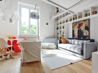 Modern living room by G*AA - Giaquinto Architetti Associati Modern