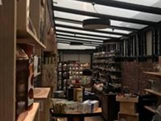 Delikatessen Bogota: Locales gastronómicos de estilo  por Heritage Design Group, Ecléctico
