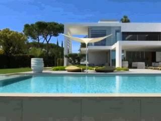 Pintura na Quinta do Lago Paredes e pisos modernos por Propaint Lda Moderno