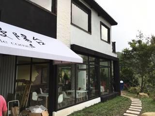 Country house by 登品空間規劃工程有限公司