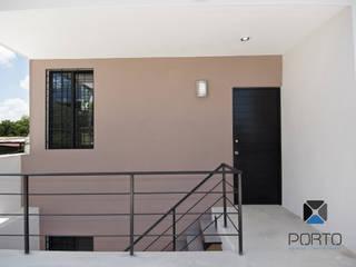 Rumah Minimalis Oleh PORTO Arquitectura + Diseño de Interiores Minimalis