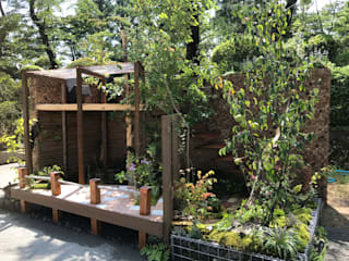 Jardines en la fachada de estilo  por 株式会社 髙橋造園土木  Takahashi Landscape Construction.Co.,Ltd