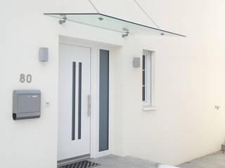 Haustüre mit Glasvordach Schmidinger Wintergärten, Fenster & Verglasungen Tür Aluminium/Zink Weiß