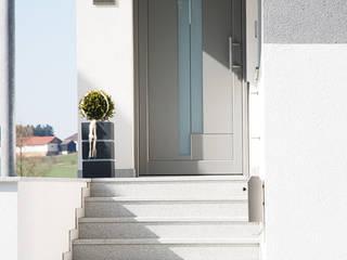 Einfamilienhaus - neue Kunststoff-Aluminium Fenster und Aluminium-Haustüre Schmidinger Wintergärten, Fenster & Verglasungen Haustür Aluminium/Zink Grau