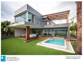 Casa Vista Lago: Casas de estilo  por Excelencia en Diseño