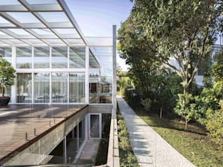 Residência Jardim do Sol: Casas  por Hype,Minimalista