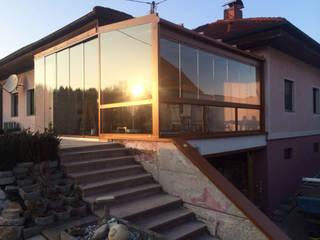 Sommergarten in der Abendsonne Schmidinger Wintergärten, Fenster & Verglasungen Rustikaler Wintergarten Aluminium/Zink Braun