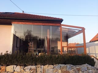 Schmidinger Wintergärten, Fenster & Verglasungen Rustic style conservatory Aluminium/Zinc Brown