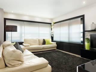Moradia remodelada, bom gosto e muito espaço. Salas de estar modernas por Miguel Marnoto - Fotografia Moderno