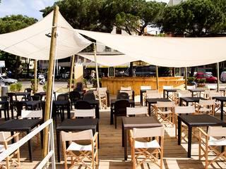 Espacios comerciales de estilo  por Luca Alitini, Mediterráneo