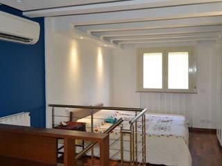 Casa MG – Lo Studio di G: Camera da letto in stile  di arch. Paolo Pambianchi