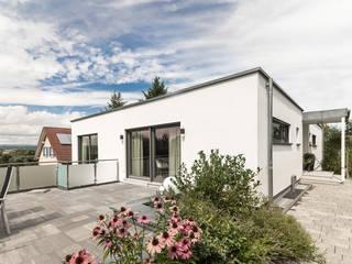 من wir leben haus - Bauunternehmen in Bayern حداثي