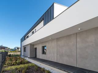 Dom jednorodzinny w Chybach koło Poznania: styl , w kategorii Domy zaprojektowany przez Offa Studio,Nowoczesny