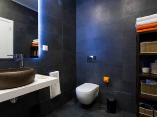 Remodelação de T2 para Airbnb: Casas de banho  por MP Architecture & Interior Design,Moderno