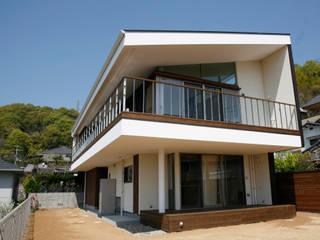松山市 高台の家: Y.Architectural Designが手掛けた家です。