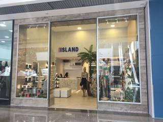 Loja Vestuário Feminino: Lojas e imóveis comerciais  por Um doce de Arquitetura,Tropical