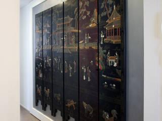 gold&grey: Ingresso & Corridoio in stile  di studio ferlazzo natoli