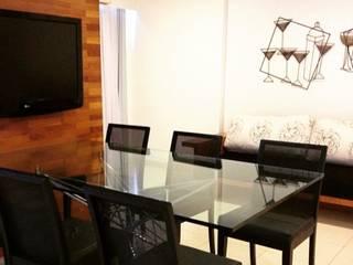 Sala Flat: Salas de jantar  por Flavia Dadalto Arquitetura,Moderno