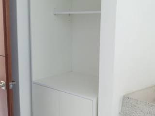 Closet para blancos:  de estilo  por Minor & Santana