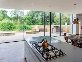 house in the garden of a listed building:  Kitchen by RPA Architects