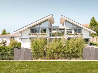 Kundenhaus Friedrichsen - Familienvilla mit Innen-Pool Moderne Häuser von DAVINCI HAUS GmbH & Co. KG Modern