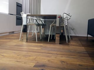 DELFINETTIDESIGN Modern dining room Wood Wood effect