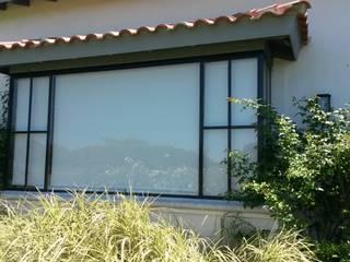 Diseño y Construcción de Casa en Haras San Pablo por Estudio Dillon Terzaghi Arquitectura: Jardines de invierno de estilo  por Estudio Dillon Terzaghi Arquitectura