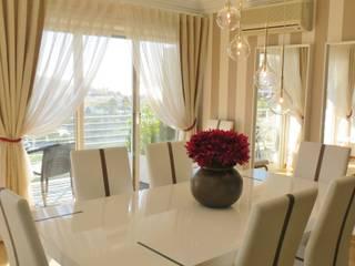 Apartamento em Carcavelos - Sala de estar e jantar: Salas de jantar  por Joana Neto | Interiores,Eclético