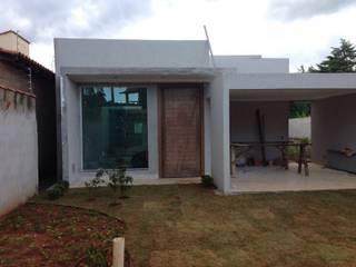 Casas unifamiliares de estilo  por Rudini Rodarte Arquitetura & Construção