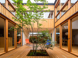 Eclectic style garden by 中山大輔建築設計事務所/Nakayama Architects Eclectic