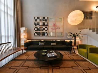 Premium Villa :  Living room by Racheta Interiors Pvt Limited