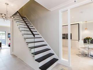Escaleras de estilo  por Model Projects Ltd