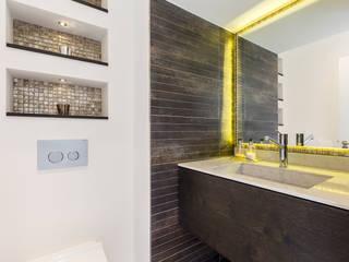 Baños de estilo  por Model Projects Ltd