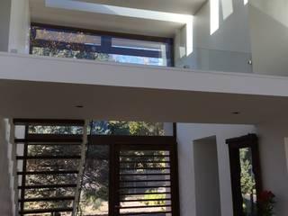 CASA CH: Casas unifamiliares de estilo  por PICHARA + RIOS arquitectos