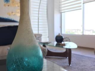 Resultado final del Departamento en Guadalajara : Salas de estilo  por Citlali Villarreal Interiorismo & Diseño