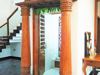 Pooja Room:  Living room by Geometrixs Architects & Engineers