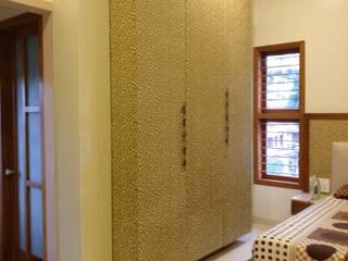 wardrobe:  Bedroom by Geometrixs Architects & Engineers