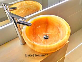 Kamienne umywalki z onyksu na blat - żółty onyks: styl , w kategorii Łazienka zaprojektowany przez Lux4home™