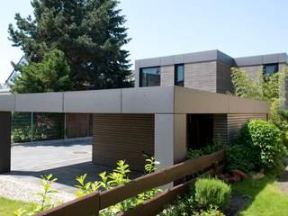 modern Garage/shed by Herrmann Massivholzhaus GmbH