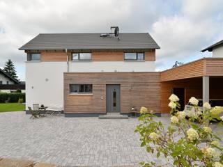 modern Houses by Herrmann Massivholzhaus GmbH