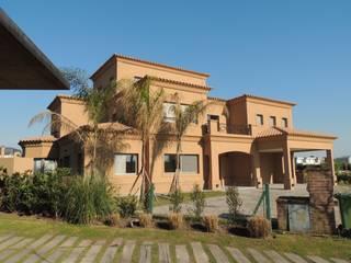 Casa Alisos: Casas unifamiliares de estilo  por Ezequiel Olivieri,Clásico