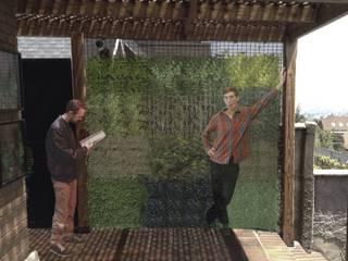 Muro verde.:  de estilo  por sur arquitectura del paisaje