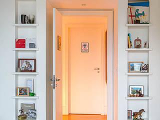 CASA JARDIM BOTÂNICO Corredores, halls e escadas modernos por Maria Claudia Faro Moderno