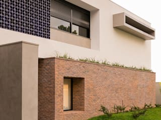 Guaraúna Revestimentos Modern home Bricks