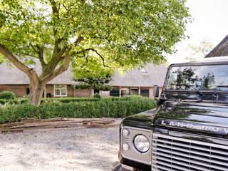 Droomhuis in Rijksmonumentale boerderij:  Tuin door ODM architecten - erfgoed & architectuur, Landelijk